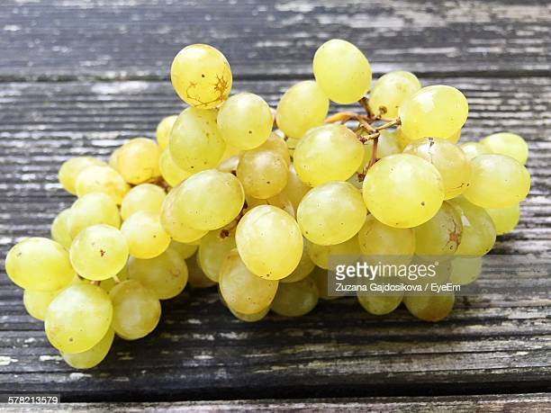 Close-Up Of Grape On Wooden Plank