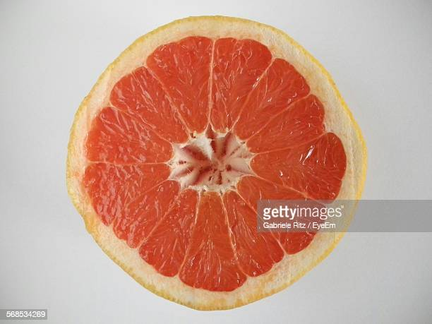 Close-Up Of Grapefruit Against White Background
