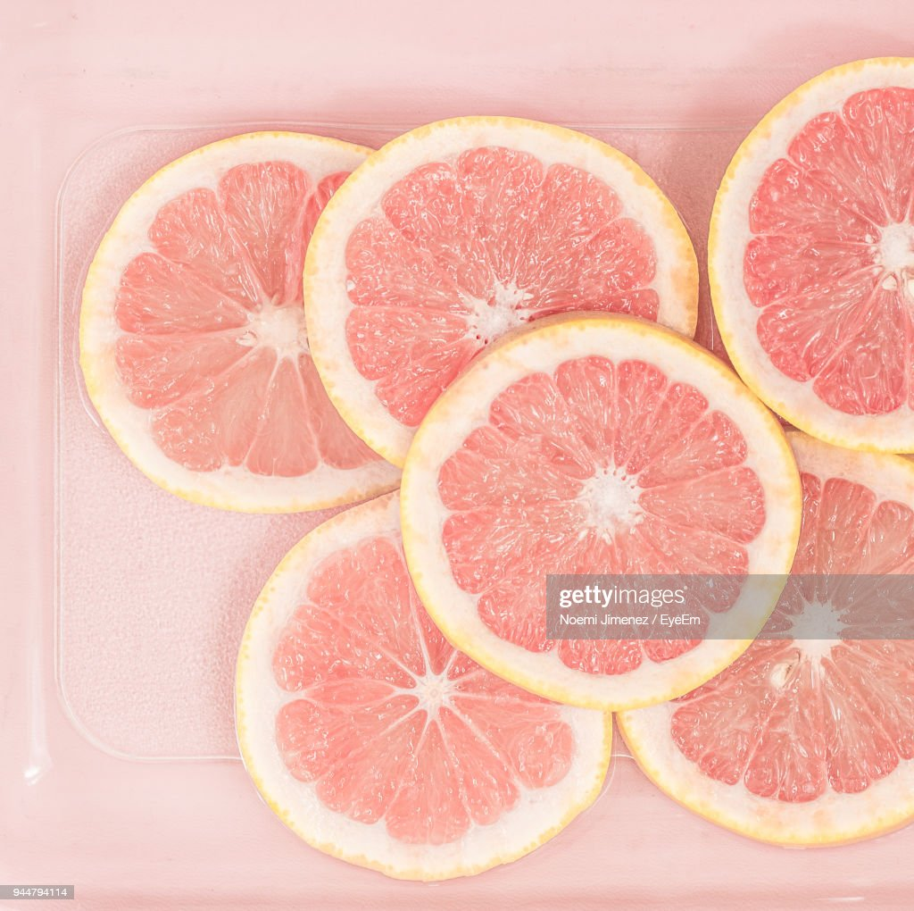 Close-Up Of Grapefruits On Plate : Stock Photo