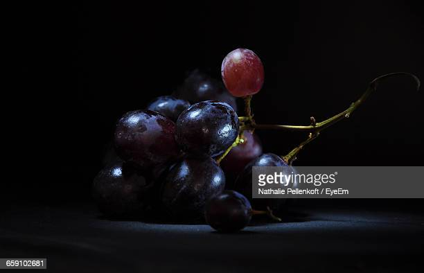 Close-Up Of Grapes Against Black Background