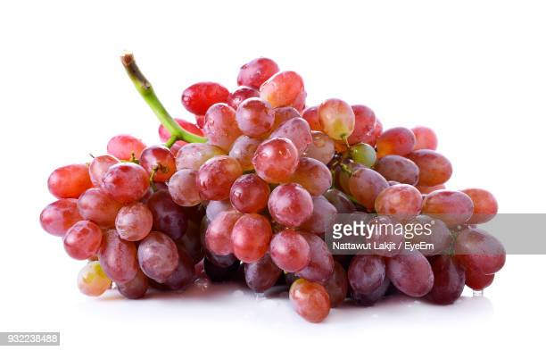 close-up of grapes against white background - grape stock pictures, royalty-free photos & images