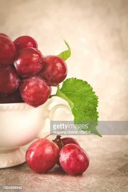 Close-Up Of Grapes In Cup On Table