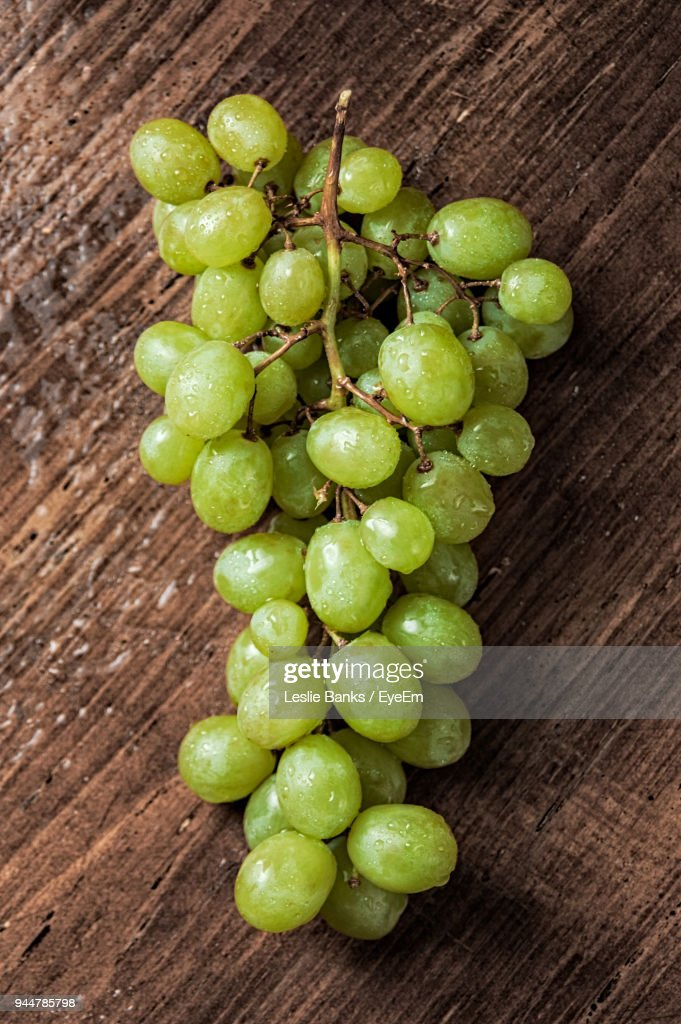 Close-Up Of Grapes On Table : Stock Photo
