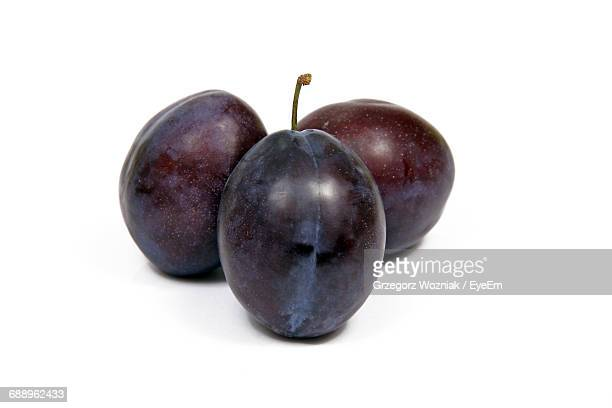 close-up of grapes over white background - red grape stock photos and pictures