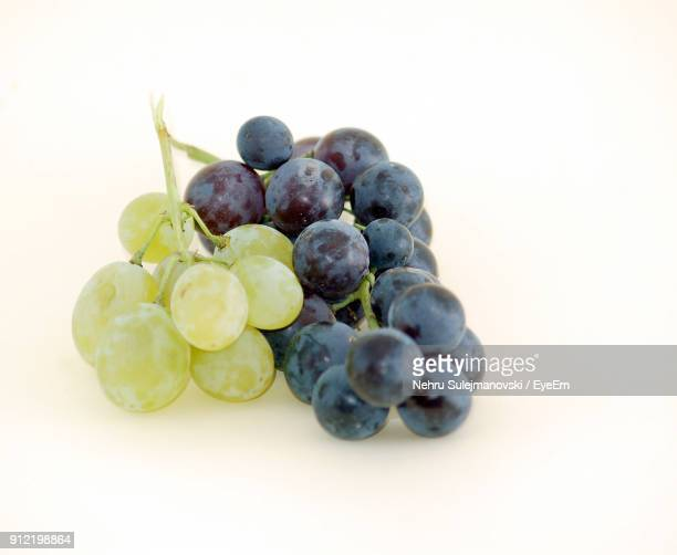 Close-Up Of Grapes Over White Background