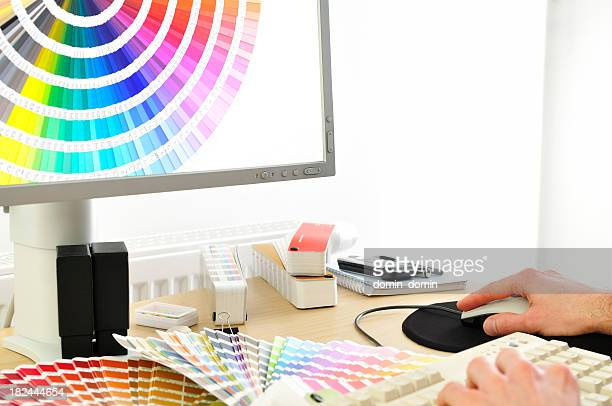 Close-up of Graphic designer choosing colour cards on lcd screen