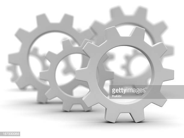 Close-up of gray gearwheels on white background