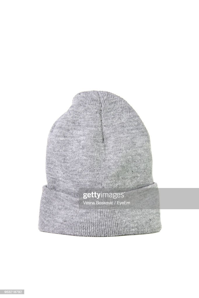 Close-Up Of Gray Knit Hat Over White Background : Stock Photo