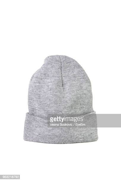 Close-Up Of Gray Knit Hat Over White Background