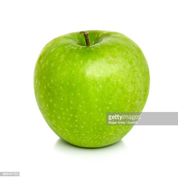 close-up of green apple against white background - apple fruit stock photos and pictures