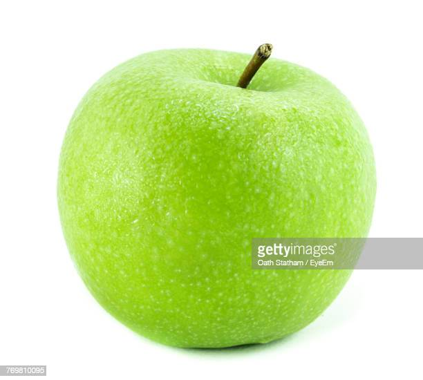 Close-Up Of Green Apple Over White Background