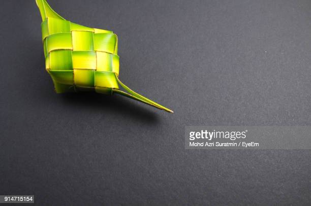 close-up of green bamboo decor over black background - black bamboo stock pictures, royalty-free photos & images
