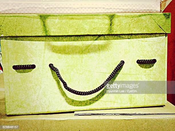 Close-Up Of Green Box With Smiley Face