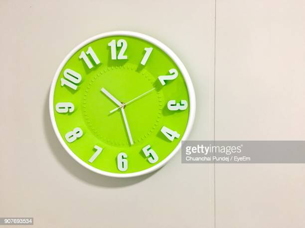 Close-Up Of Green Clock On Wall