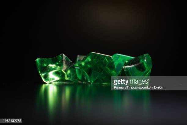 close-up of green crystals on black background - gemstone stock pictures, royalty-free photos & images