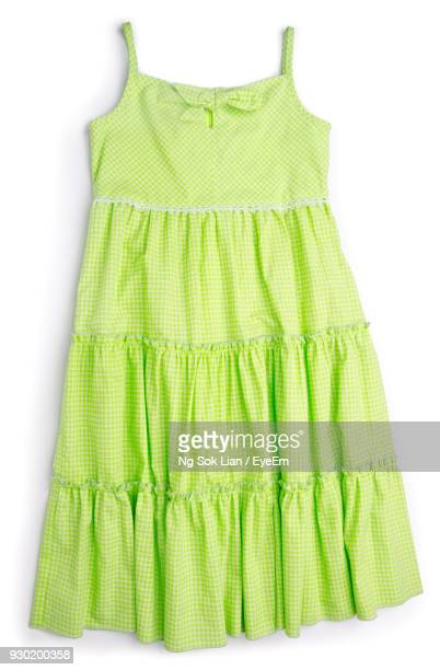 close-up of green dress against white background - green dress stock pictures, royalty-free photos & images