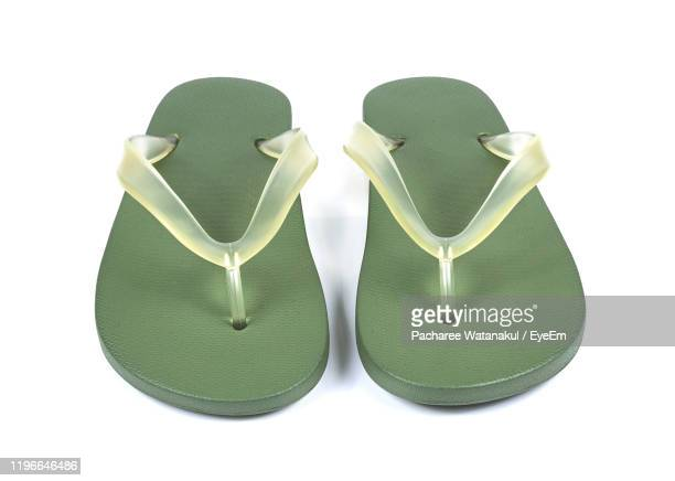 close-up of green flip-flops against white background - open toe stock pictures, royalty-free photos & images