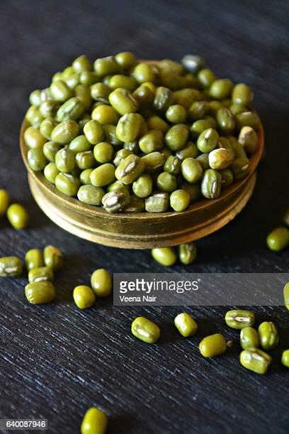 Close-up of Green gram/Mung bean/Moong Dal in a brass utensil