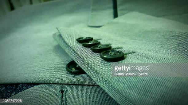 close-up of green jacket - green coat stock pictures, royalty-free photos & images