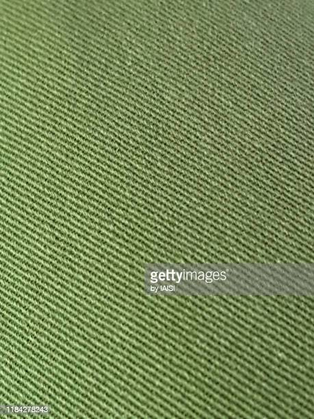 close-up of green/ khaki fabric, full frame - khaki stock pictures, royalty-free photos & images