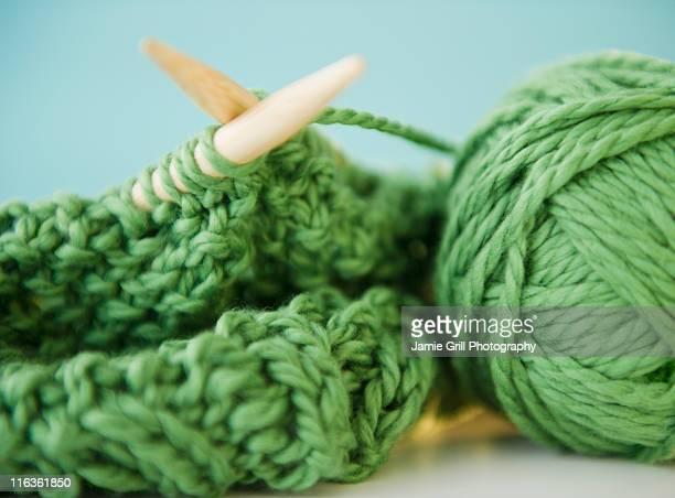 Close-up of green knitwear and yarn