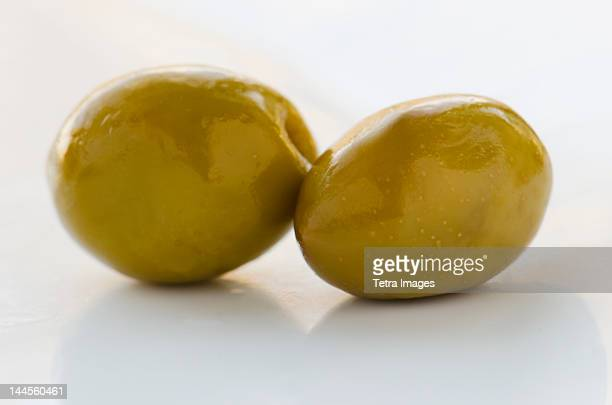 Close-up of green olives, studio shot