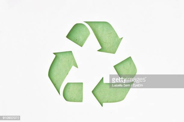 close-up of green symbol over white background - recycling stock pictures, royalty-free photos & images