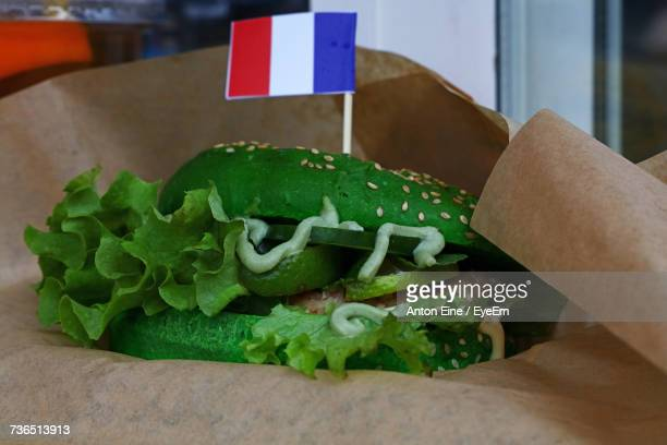 Close-Up Of Green Vegetarian Burger With Dutch Flag On Brown Paper