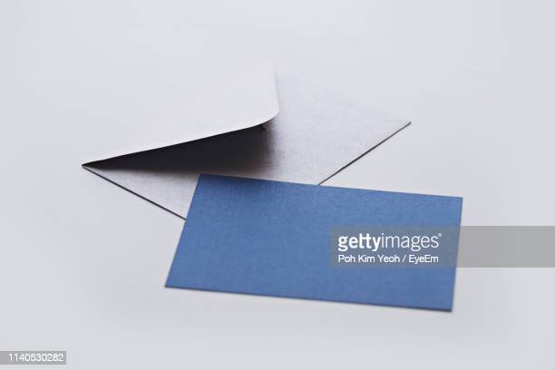 close-up of greeting card and envelope on white background - 封筒 ストックフォトと画像