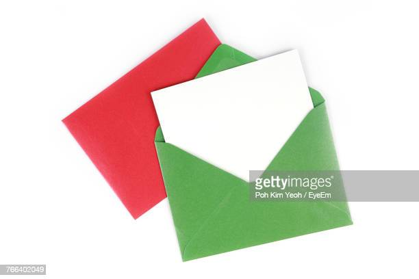 close-up of greeting cards over white background - envelope stock pictures, royalty-free photos & images