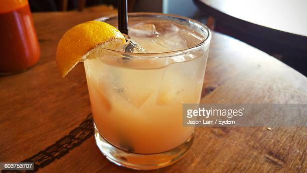 close-up of greyhound cocktail in glass on wooden table - greyhound bus stock pictures, royalty-free photos & images