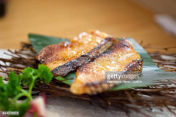 Close-Up Of Grilled Fish Served On Table