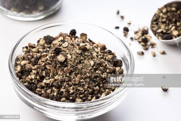 Close-Up Of Ground Black Peppercorn In Bowl On White Table