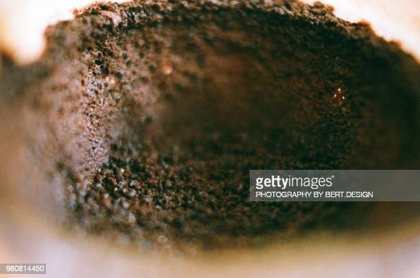 close-up of ground coffee in filter - ground coffee stock photos and pictures