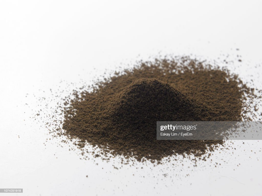 Close-Up Of Ground Coffee Over White Background : Stock Photo