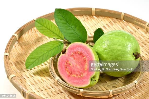 close-up of guava in basket - guava fruit stock photos and pictures