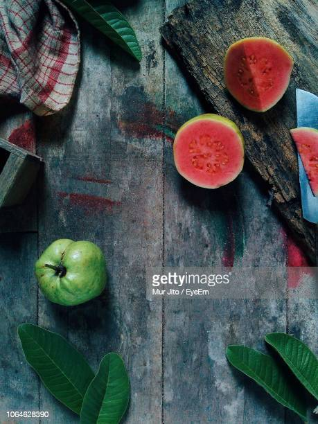 close-up of guava on table - guava fruit stock photos and pictures