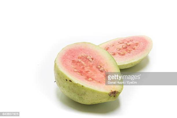 close-up of guava over white background - guava fruit stock photos and pictures