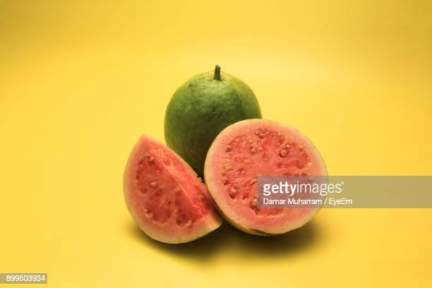 close-up of guava over yellow background - guava fruit stock photos and pictures