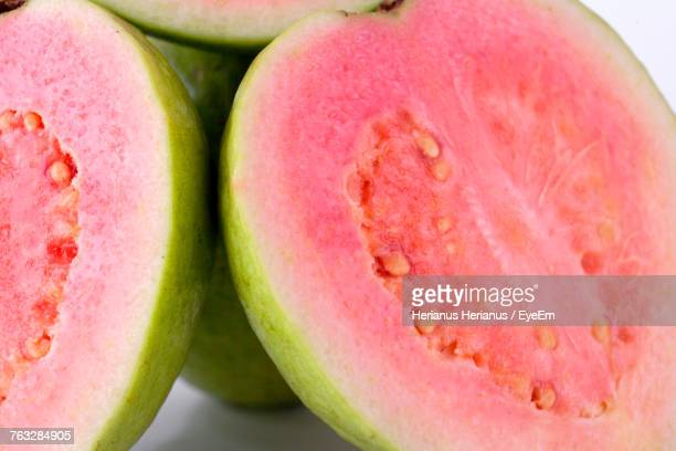 close-up of guavas against white background - guava fruit stock photos and pictures