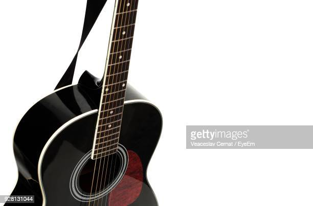close-up of guitar against blue background - string instrument stock photos and pictures