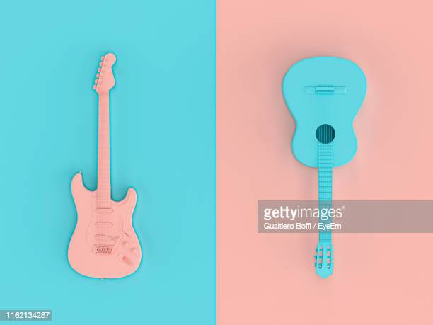 close-up of guitar against colored background - gitarre stock-fotos und bilder