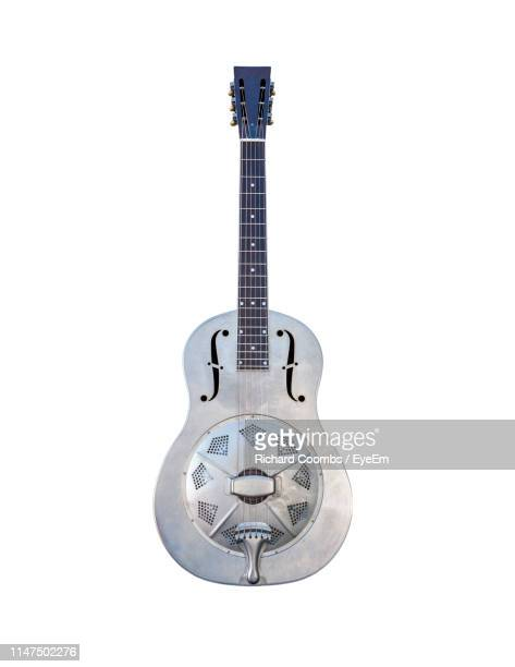 close-up of guitar against white background - electric guitar stock pictures, royalty-free photos & images