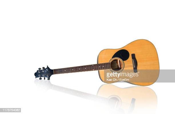 close-up of guitar against white background - stringed instrument stock pictures, royalty-free photos & images