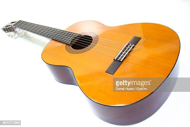 close-up of guitar against white background - acoustic guitar stock pictures, royalty-free photos & images