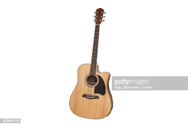 close-up of guitar against white background - gitarre stock-fotos und bilder