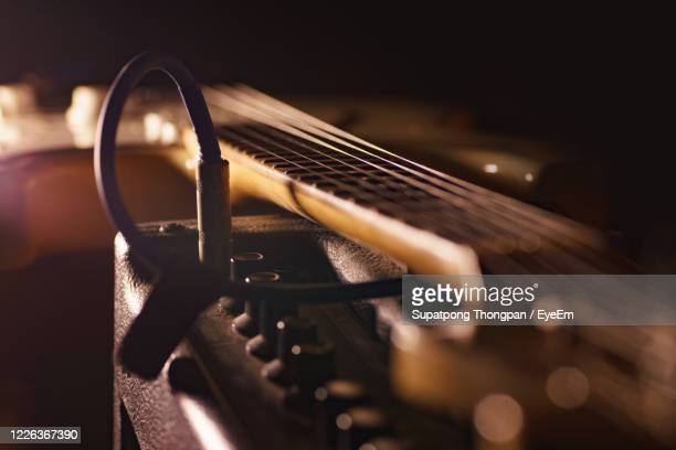 close-up of guitar on amplifier - amplifier stock pictures, royalty-free photos & images