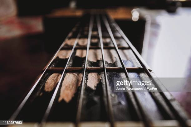 close-up of guitar on table - classical guitar stock photos and pictures
