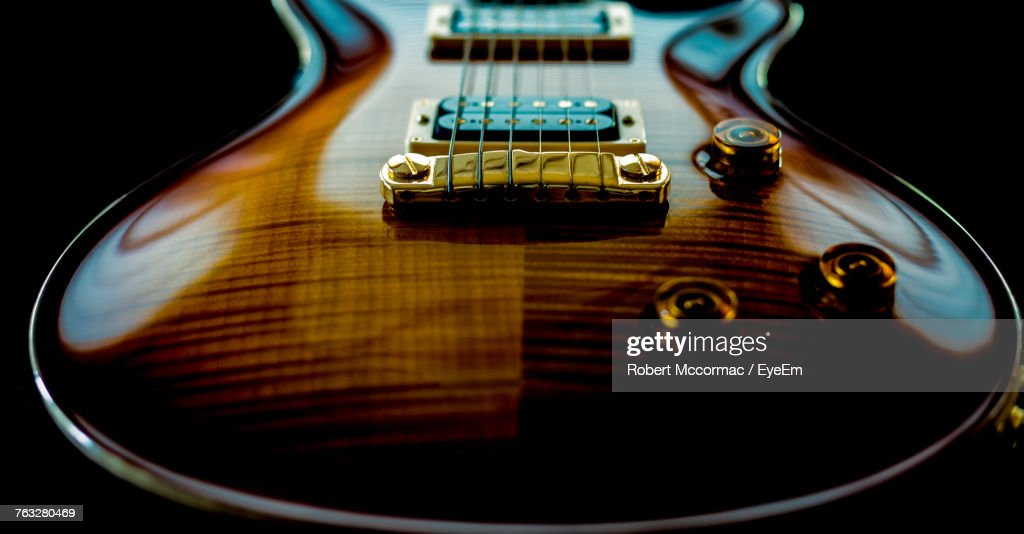 Close-Up Of Guitar Over Black Background : Stock Photo