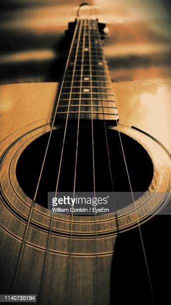close-up of guitar - classical guitar stock photos and pictures